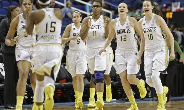 Georgia Tech players Katarina Vuckovic (10), Frida Fogdemark (12), Nariah Taylor (11), and Kymberly Ellison (5), run to teammate Tyaunna Marshall (15) at the end of an NCAA college basketball game against Virginia at the Atlantic Coast Conference tournament in Greensboro, N.C., Thursday, March 6, 2014. Georgia Tech won 77-76. (AP Photo/Chuck Burton)