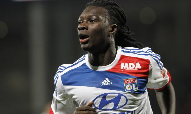 Lyon's Bafe Gomis celebrates after scoring against Montpellier during their French League One soccer match at Gerland stadium, in Lyon, central France, Saturday, Dec. 1, 2012. (AP Photo/Laurent Cipriani)