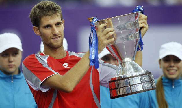 Martin Klizan of Slovakia holds his trophy after winning the final match against Fabio Fognini of Italy at the St. Petersburg Open ATP tennis tournament in St.Petersburg, Russia, Sunday, Sept. 23, 2012. (AP Photo/Dmitry Lovetsky)