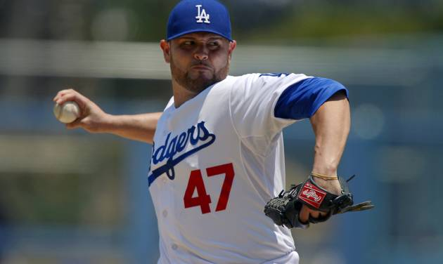 Los Angeles Dodgers starting pitcher Ricky Nolasco throws to the plate during the first inning of their baseball game against the Colorado Rockies, Sunday, July 14, 2013, in Los Angeles. (AP Photo/Mark J. Terrill)