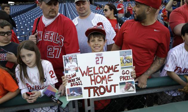 Justin Shephard, nine years old, from Deptford, N.J., holds up a sign for Los Angeles Angels' Mike Trout before the start of a baseball game with the Philadelphia Phillies, Tuesday, May 13, 2014, in Philadelphia. (AP Photo/Laurence Kesterson)