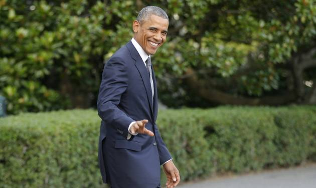 President Barack Obama walks on the South Lawn at the White House in Washington, Friday, July 18, 2014, as he boards Marine One helicopter to the presidential retreat at Camp David, Md. (AP Photo/Charles Dharapak)