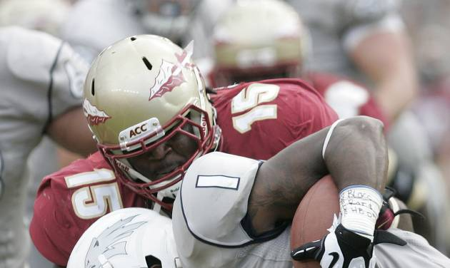 FILE - In this Sept. 14, 2013, file photo, Florida State's Mario Edwards (15) tackles Nevada's Brandon Wimberly in the second quarter of an NCAA college football game in Tallahassee, Fla. Edwards is everything a coach wants in a defensive lineman _ a rare combination of power and agility. (AP Photo/Steve Cannon, File)