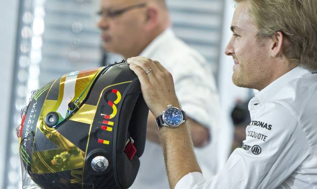 World Cup leader and Mercedes Formula One driver Nico Rosberg of Germany holds a helmet during a press conference in Hockenheim, Germany, Thursday, July 17, 2014. The German Grand Prix will be held on Sunday, July 20, 2014. (AP Photo/Jens Meyer)