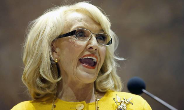 FILE - In this Jan. 13, 2014 file photo, Arizona Gov. Jan Brewer speaks during her State of the State address at the Arizona Capitol in Phoenix. The Republican governor faced intensifying pressure Tuesday from CEOs, politicians in Washington and state lawmakers in her own party to veto a bill that would allow business owners with strongly held religious beliefs to deny service to gays and lesbians. (AP Photo/Ross D. Franklin, File)