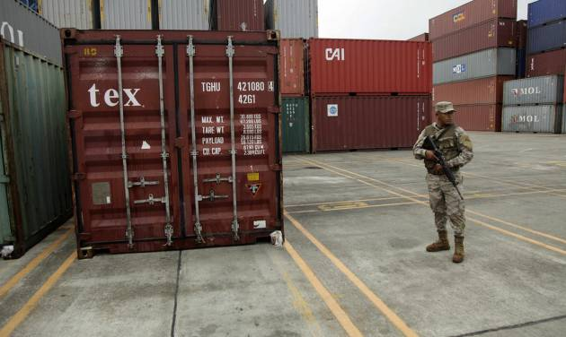 FILE - In this July 17, 2013 file photo, a police officer stands guard aboard the North Korean-flagged freighter Chong Chon Gang carrying containers, at the Manzanillo International container terminal on the coast of Colon City, Panama.  Crews unloading the ship detained in the Panama Canal for carrying undeclared arms from Cuba have found live munitions aboard, a Panamanian official said Friday, Aug. 2, 2013. (AP Photo/Arnulfo Franco, File)