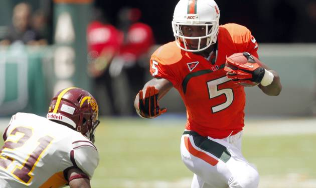 FILE - In this Sept. 15, 2012, file photo, Miami running back Mike James (5) runs against Bethune-Cookman defensive back Tim Burke (21) during the first half of an NCAA college football game in Miami. The last time the Hurricanes played the Irish, his mother's funeral coincided with kickoff. James said Notre Dame didn't see his best that day _ but vows the Irish will when the teams meet in Chicago on Saturday. (AP Photo/Wilfredo Lee, File)