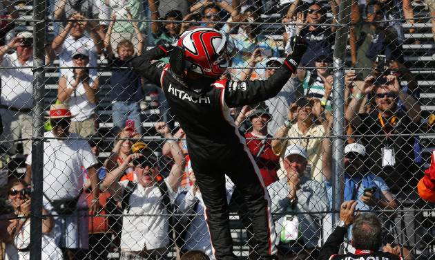 Helio Castroneves celebrates winning the second race of the IndyCar Detroit Grand Prix auto racing doubleheader in Detroit Sunday, June 1, 2014. (AP Photo/Paul Sancya)