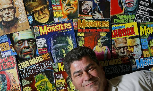 Eric Gesecus poses for a photo with copies of Monsters magazines inside his Piedmont, Okla., home...