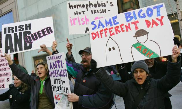 FILE - In a March 17, 2006 file photo, members of the Irish-American gay community protest on Fifth Avenue against the exclusion of Irish and Irish-American gays people from marching in the annual St. Patrick's Day Parade Friday, in New York. Organizers of the world's largest St. Patrick's Day Parade say they're ending a ban and allowing a gay group to march under its own banner for the first time. The parade committee, in a statement made available to The Associated Press, said on Wednesday, Sept. 3, 2014, that OUT@NBCUniversal, a lesbian, gay, bisexual and transgender support group at the company that broadcasts the parade, would be marching up Manhattan's Fifth Avenue on March 17 under an identifying banner. (AP Photo/Dima Gavrysh, File)