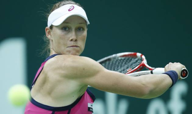 Australia's Samantha Stosur returns a ball to Serbia's Ana Ivanovic during a semifinal match at the Kremlin Cup tennis tournament in Moscow, Russia, Saturday, Oct. 20, 2012. (AP Photo/Misha Japaridze)