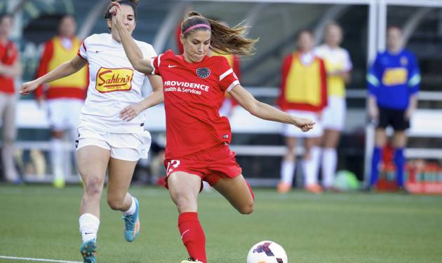 The Portland Thorns Alex Morgan (13), playing for the first time this season, prepares to fire a shot though the Thorns to fall behind the Western NY Flash, 4-0, at the end of the first half at Providence Park Saturday night June 7, 2014 in Portland.  (AP Photo/The Oregonian, Randy L. Rasmussen)