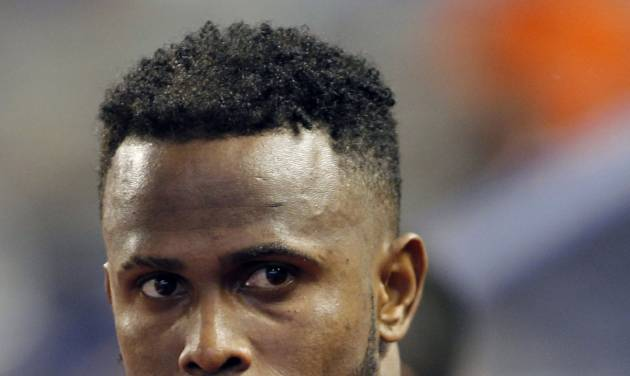 FILE - In this Sept. 2, 2012, file photo, Miami Marlins shortstop Jose Reyes appears in the dugout during a baseball game against the New York Mets in Miami. A person familiar with the deal told The Associated Press on condition of anonymity Tuesday, Nov. 13, that the Marlins have traded Reyes to the Toronto Blue Jays. (AP Photo/Alan Diaz, File)