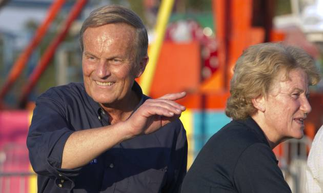 "Senate candidate Rep. Todd Akin, R-Mo., campaigns his wife Lulli, right, during the Northwest Missouri State Fair in Bethany, Mo., Thursday, Aug. 30, 2012. It was Akin's first public interaction with voters since his Aug. 19 comment in a TV interview that women's bodies have ways of averting pregnancy from what he called ""legitimate rape."" The comment prompted widespread backlash, with some Republicans urging him to quit the race against Democratic Sen. Claire McCaskill. (AP Photo/Orlin Wagner)"