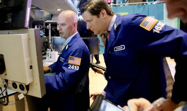In a photo made Thursday, Sept. 6, 2012, traders work the floor of the New York Stock Exchange. This week Federal Reserve officials will meet and are expected to announce steps to prop up the ailing U.S. economy. (AP Photo/David Karp)