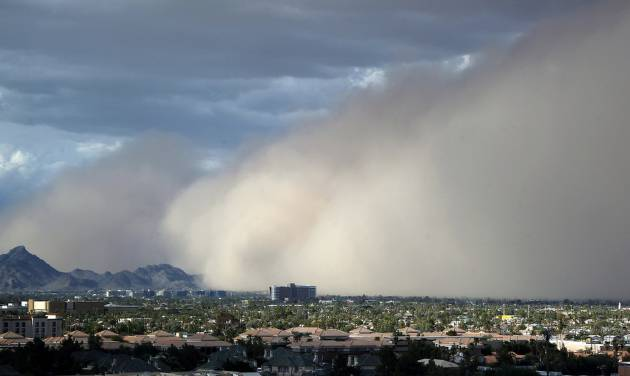 A large dust storm, or haboob, sweeps across downtown Phoenix, Saturday afternoon, July 21, 2012. Dust storms are common across Arizona during the summer, and walls of dust more than a mile high can blanket an area in a matter of seconds, sometimes reducing visibility to zero..(AP Photo/Ross D. Franklin)