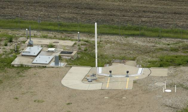 """This photo taken June 24, 2014 shows an ICBM launch site located among fields in the countryside outside Minot, N.D. on the Minot Air Force Base. The nuclear missiles hidden in plain view across the prairies of northwest North Dakota reveal one reason why trouble keeps finding the nuclear Air Force. The """"Big Stick,"""" as some call the 60-foot-tall Minuteman 3 missile, is just plain old. (AP Photo/Charlie Riedel)"""