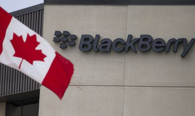 A Canadian flag flies at BlackBerry's headquarters in Waterloo, Ont., Tuesday, July 9, 2013. Research In Motion has won formal approval to change its name to BlackBerry. The Canadian company announced plans for the name change in January, when it unveiled new phones running a revamped operating system called BlackBerry 10. The company hopes the new devices will be more competitive with iPhones and Android devices. (AP Photo/The Canadian Press, Geoff Robins)