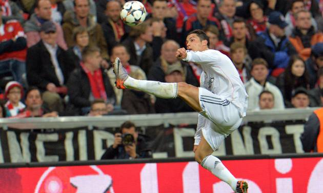 Real's Cristiano Ronaldo jumps for the ball during the Champions League semifinal second leg soccer match between Bayern Munich and Real Madrid at the Allianz Arena in Munich, southern Germany, Tuesday, April 29, 2014. (AP Photo/Kerstin Joensson)