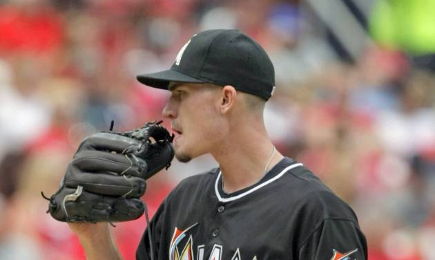 Miami Marlins starting pitcher Andrew Heaney regroups after giving up back-to-back home runs in the fourth inning of a baseball game against the St. Louis Cardinals, Saturday, July 5, 2014, in St. Louis.(AP Photo/Tom Gannam)