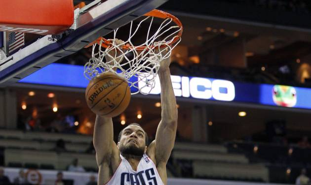 Charlotte Bobcats' Jeffery Taylor (44) dunks over Washington Wizards' Trevor Ariza (1) and Trevor Booker (35) during the first half of an NBA basketball game in Charlotte, N.C., Tuesday, Nov. 13, 2012. (AP Photo/Chuck Burton)