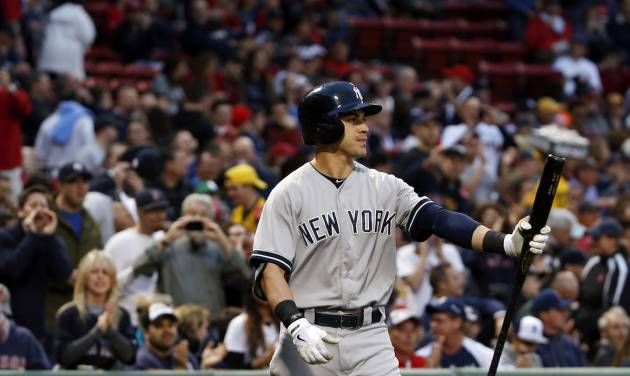 New York Yankees' Jacoby Ellsbury is booed by fans as he walks to the plate for his first at-bat during the first inning of a baseball game at Fenway Park in Boston, Tuesday, April 22, 2014. (AP Photo/Elise Amendola)