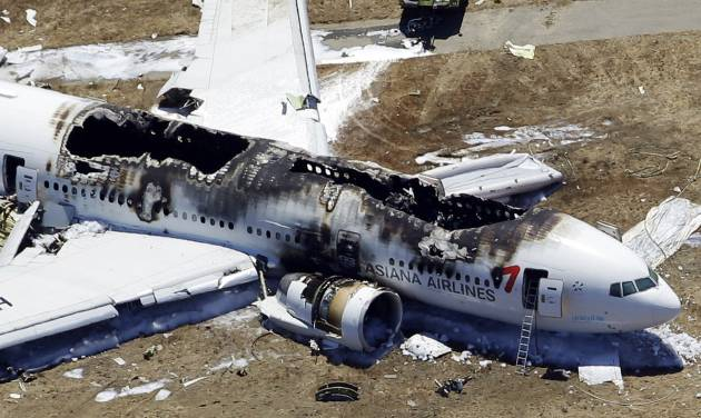 FILE - In this July 6, 2013 file aerial photo shows the wreckage of the Asiana Flight 214 airplane after it crashed at the San Francisco International Airport in San Francisco. A ban on video cameras by the  San Francisco fire department   now explicitly includes helmet-mounted ones filming emergency scenes, according to Chief Joanne Hayes-White. The edict comes after images taken in the aftermath of the July 6 Asiana Airlines crash at San Francisco International Airport were made public, leading to questions about first responders actions that resulted in a survivor being run over by a fire truck. (AP Photo/Marcio Jose Sanchez, File)