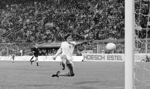 FILE - In this July 3, 1974 file photo, Dutch forward Johann Cruyff scores his team?s second goal against Brazil in their World Cup Soccer match, in Dortmund, West Germany. On this day: The Netherlands beats Brazil 2-0 to qualify for the World Cup final. (AP Photo, File)