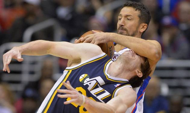 Los Angeles Clippers forward Hedo Turkoglu, top, of Turkey, rips the ball away from Utah Jazz guard Gordon Hayward during the second half of an NBA basketball game, Saturday, Feb. 1, 2014, in Los Angeles . (AP Photo/Mark J. Terrill)