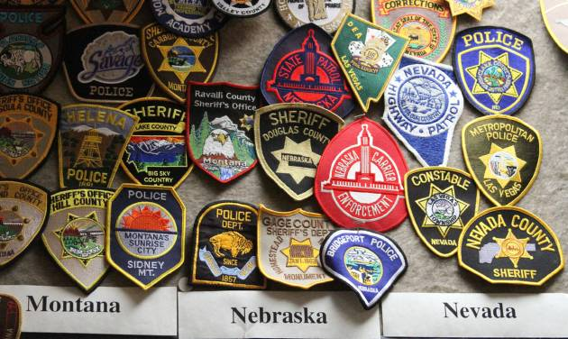 This photo taken July 8, 2014, shows some of the police department badges from other states and displayed the Alaska State Trooper Museum in Anchorage, Alaska. The free museum offers a history of law enforcement in Alaska dating back to territorial days.  (AP Photo/Mark Thiessen)