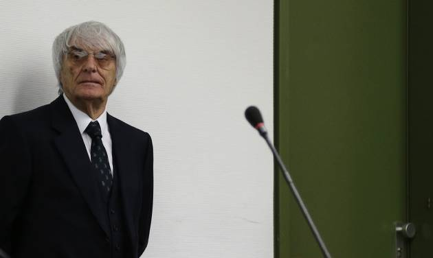 "Formula One boss Bernie Ecclestone arrives for his trial in the regional court in Munich, southern Germany, Tuesday, July 29, 2014. Ecclestone is charged with bribery and incitement to breach of trust ""in an especially grave case"" over a US $44 million payment to a German banker, that prosecutors allege was meant to facilitate the sale of the Formula One Group to a buyer of Ecclestone's liking.  (AP Photo/Matthias Schrader,Pool)"