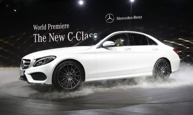 Mercedes Benz unveils the new C-Class car during a preview night for the North American International Auto Show in Detroit, Sunday, Jan. 12, 2014. (AP Photo/Carlos Osorio)