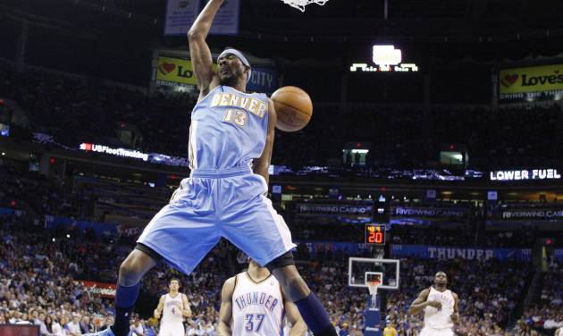 Denver Nuggets forward Corey Brewer dunks in front of Oklahoma City Thunder guard Derek Fisher (37) during the first quarter of an NBA basketball game in Oklahoma City, Wednesday, April 25, 2012. (AP Photo/Sue Ogrocki)