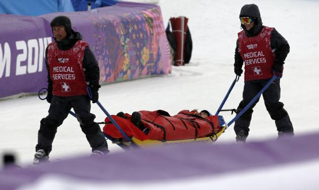Italy's Omar Visintin is carried off the course in a stretcher after crashing in the second semifinal of the men's snowboard cross at the Rosa Khutor Extreme Park, at the 2014 Winter Olympics, Tuesday, Feb. 18, 2014, in Krasnaya Polyana, Russia. (AP Photo/Andy Wong)