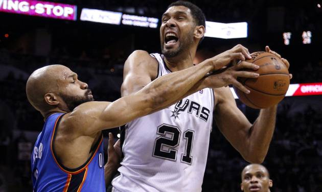 Oklahoma City's Derek Fisher (6) defends against San Antonio's Tim Duncan (21) during Game 1 of the Western Conference Finals in the NBA playoffs between the Oklahoma City Thunder and the San Antonio Spurs at the AT&T Center in San Antonio, Monday, May 19, 2014. Photo by Sarah Phipps, The Oklahoman