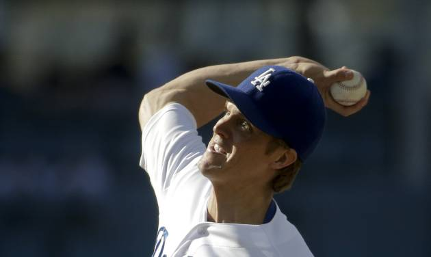 Los Angeles Dodgers starting pitcher Zack Greinke throws against the Pittsburgh Pirates during first inning of a baseball in Los Angeles, Sunday, June 1, 2014. (AP Photo/Chris Carlson)