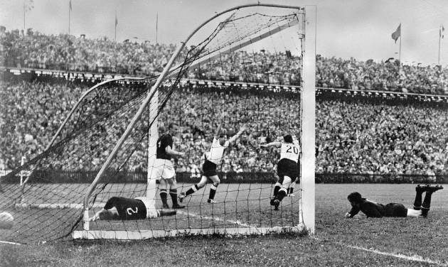 FILE - In this July 4, 1954 file photo, West Germany's Helmut Rahn, center with arms raised, celebrates after equalising in the World Cup soccer final match against Hungary, at Wankdorf Stadium, in Bern, Switzerland. On this day: West Germany comes back from 2-0 down to beat Hungary 3-2 and win its first World Cup. (AP Photo/File)