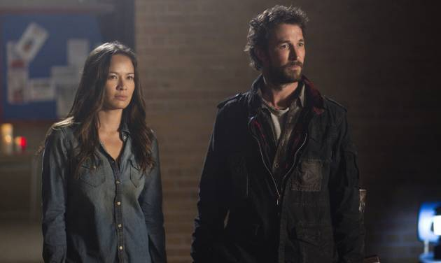 "In this undated photo released by TNT, actors, Moon Bloodgood, left, and Noah Wyle, appear in a scene from TNT's ""Falling Skies"" Season Finale - Part 1: ""Mutiny."" Wyle is confronting an alien invasion, the death of his wife and the potential annihilation of the human species in the new season of ""Falling Skies,"" which debuts Sunday, June 17, 2012, 9-11 p.m. EDT on TNT. (AP Photo/TNT, Ken Woroner)"