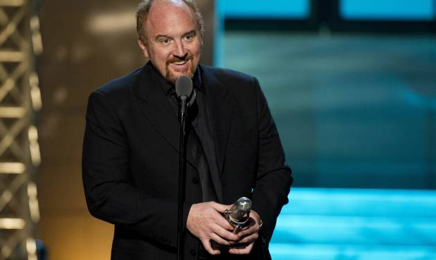 """FILE - In this April 28, 2012 photo, comedian Louis C.K. appears onstage at The 2012 Comedy Awards in New York. When Louis C.K. released his comedy special """"Live at the Beacon Theater"""" by himself on his website for $5, it was little more than a cautiously optimistic experiment. Less than two weeks later, it had reaped more than $1 million. Already among the most respected stand-ups in the country, Louis C.K. was suddenly a new media trailblazer, too. On Tuesday, the Webby Awards announced Louis C.K. is their """"person of the year"""" for setting """"a new precedent for distribution."""" Comedians Aziz Ansari and Jim Gaffigan have since similarly released albums online. (AP Photo/Charles Sykes, file)"""