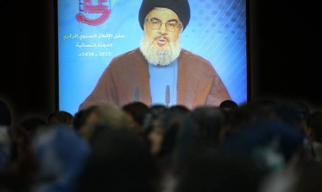 People gather to watch Hezbollah leader Sheik Hassan Nasrallah deliver a televised speech, during an iftar, the meal that breaks the dawn-to-dusk fast during the holy month of Ramadan, in a southern suburb of Beirut, Lebanon, Wednesday July 24, 2013. The leader of Lebanon's Hezbollah has accused European countries of capitulating to U.S. and Israeli pressures by blacklisting the group. The European Union's 28 foreign ministers placed Hezbollah's military wing on the bloc's terror list Monday after prolonged diplomatic pressure from the U.S. and Israel, both which consider the group a terrorist organization. (AP Photo/Hussein Malla)