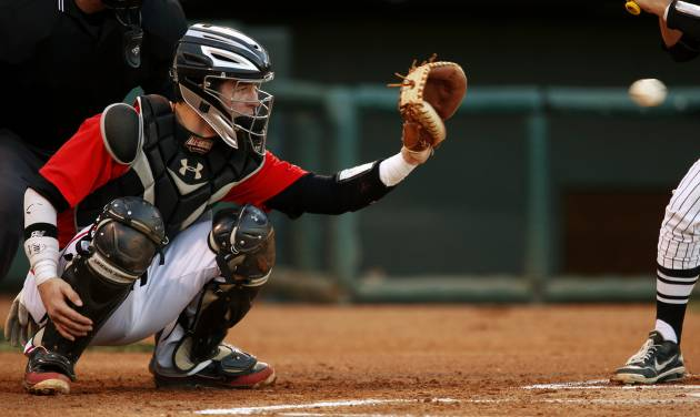 Yukon's Jon Denney catches during a high school baseball game at the Chickasaw Bricktown Ballpark in Oklahoma City, Thursday, March 14, 2013. Photo by Bryan Terry, The Oklahoman
