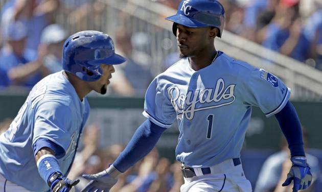 Kansas City Royals' Jarrod Dyson (1) celebrates with Emilio Bonifacio after scoring on a wild pitch thrown by Seattle Mariners starting pitcher Felix Hernandez during the fifth inning of a baseball game Monday, Sept. 2, 2013, in Kansas City, Mo. (AP Photo/Charlie Riedel)