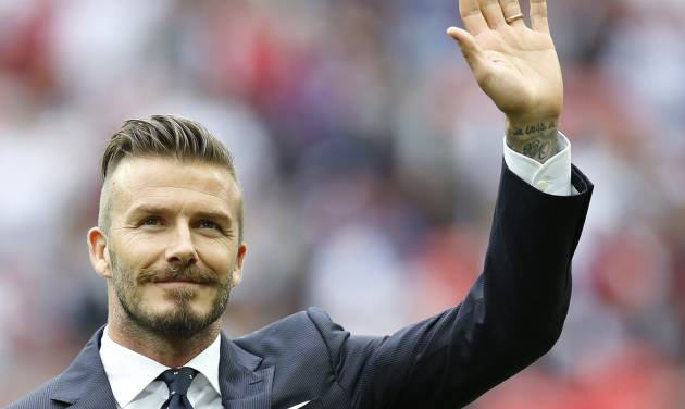 """FILE This Saturday, June 2, 2012 file photo shows England's David Beckham in a special half-time ceremony to honor the five players that have played for England over 100 times each during the international friendly soccer match between England and Belgium at Wembley Stadium in London. Former England captain David Beckham has failed to make the British football team for the London Olympics. The Los Angeles Galaxy midfielder made Britain coach Stuart Pearce's shortlist of 35 but wasn't selected for the final 18-man squad as one of three players over the age of 23 allowed to compete in the games. """"Everyone knows how much playing for my country has always meant to me, so I would have been honored to have been part of this unique Team GB squad,"""" the 37-year-old Beckham said Thursday June 28, 2012 in a statement to The Associated Press.(AP Photo/Kirsty Wigglesworth)"""