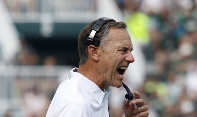 Michigan State coach Mark Dantonio yells during the fourth quarter of an NCAA college football game against South Florida, Saturday, Sept. 7, 2013, in East Lansing, Mich. Michigan State won 21-6. (AP Photo/Al Goldis)