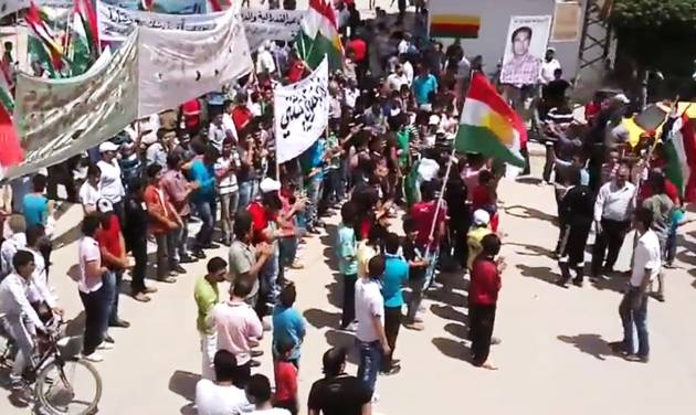 This image made from amateur video released by the Shaam News Network and accessed Friday, May 4, 2012, purports to show Syrians chanting slogans and caring Kurdish flags during a demonstration in Qamishli, the capital of Syria's Kurdish heartland. (AP Photo/Shaam News Network via AP video) TV OUT, THE ASSOCIATED PRESS CANNOT INDEPENDENTLY VERIFY THE CONTENT, DATE, LOCATION OR AUTHENTICITY OF THIS MATERIAL
