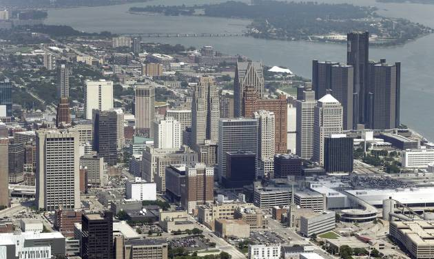 In this July 16, 2013 aerial file photo, the downtown of the city of Detroit is shown. Detroit Emergency Manager Kevyn Orr raised more than a few eyebrows a year ago when he took the city into bankruptcy and predicted it would be out by the time his term expired in fall 2014. Because it is by far the largest city to file for municipal bankruptcy and the issues were so complex many experts predicted it would take years to resolve. But the city will take a major step toward that goal with a trial in federal bankruptcy court that starts Tuesday, Sept 2, 2014. (AP Photo/Paul Sancya, File)