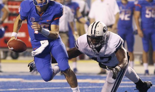 Boise State's Joe Southwick scrambles as Bingham Young's Ezekiel Ansah dives for him during an NCAA college football game Thursday, Sept. 20, 2012, in Boise, Idaho. (AP Photo/The Times-News, Drew Nash)