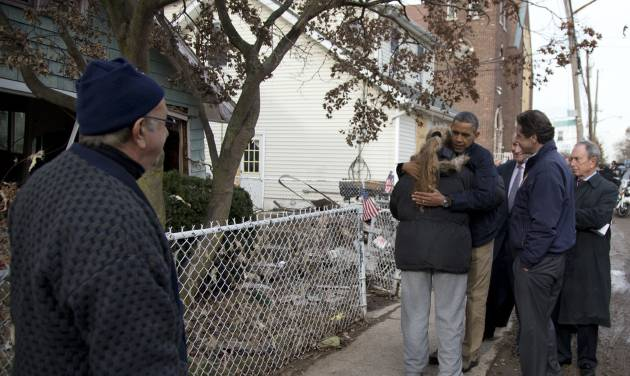 President Barack Obama, accompanied by New York City Mayor Michael Bloomberg, New York Gov. Andrew Cuomo and Sen. Charles Schumer, D-N.Y., hugs Debbie Ingenito on Cedar Grove Avenue, a street significantly impacted by Superstorm Sandy, Thursday, Nov. 15, 2012, on Staten Island, in New York. (AP Photo/Carolyn Kaster)