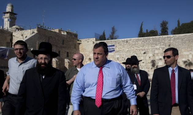 New Jersey Gov. Chris Christie, center, walks at the Western Wall, the holiest site where Jews can pray, during his visit to Jerusalem's old city, Monday, April 2, 2012. Christie kicked off his first official overseas trip Monday meeting Israel's leader in a visit that may boost the rising Republican star's foreign policy credentials ahead of November's presidential election. (AP Photo/Sebastian Scheiner)