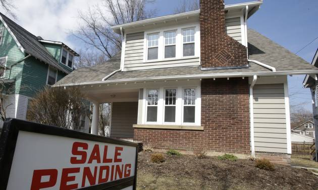 This Friday, March 21, 2014 photo shows a home for sale in Cleveland Heights, Ohio. The National Association of Realtors releases pending home sales index for February, on Thursday, March, 27, 2014. (AP Photo/Tony Dejak)
